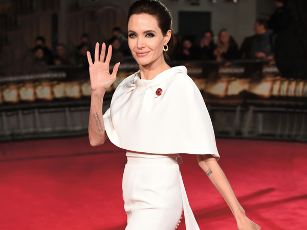 Mandatory Credit: Photo by David Fisher/REX Shutterstock (4271212bx) Angelina Jolie 'Unbroken' film premiere, London, Britain - 25 Nov 2014 WEARING RALPH & RUSSO SAME OUTFIT as catwalk model