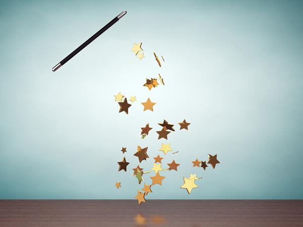 Old Style Photo. Magic wand casting shiny golden stars