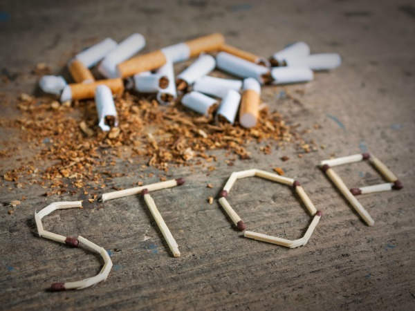 Broken cigarettes and tobacco. Quit smoking now