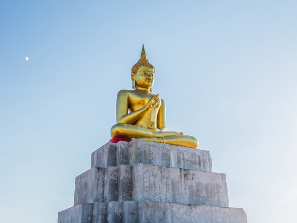 golden Buddha statue in front the park