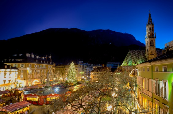 Christmas market in Bolzano with lights and decorations in Walther Square