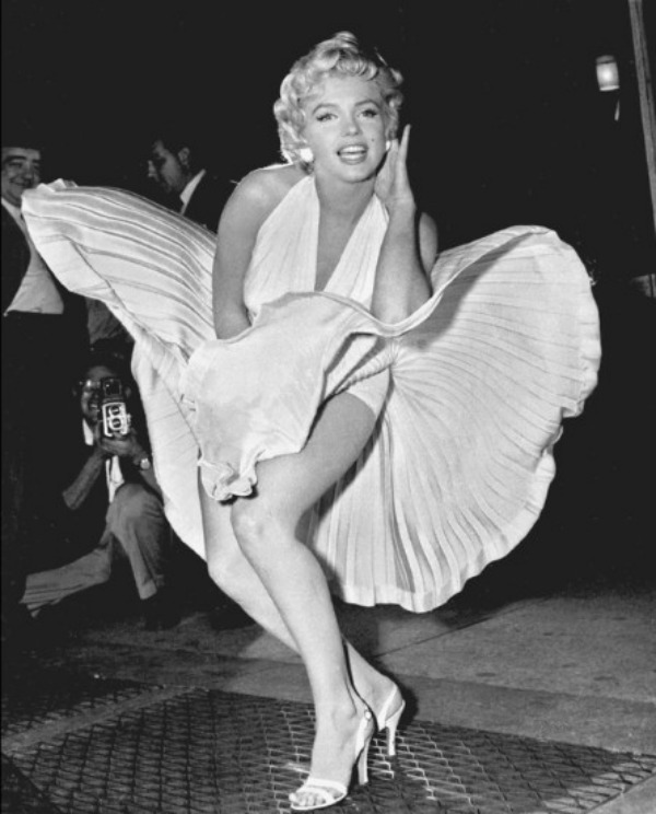 """Marilyn Monroe poses over the updraft of New York subway grating while in character for the filming of """"The Seven Year Itch"""" in Manhattan on September 9, 1954. The former Norma Jean Baker modeled and starred in 28 movies grossing $200 million. Sensual and seductive, but with an air of innocence, Monroe became one of the world's most adored sex symbols. She died alone by suicide, at age 36 in her Hollywood bungalow. (AP Photo/Matty Zimmerman)"""